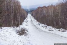«Грузовики едут вереницей». Началось строительство «путинской» дороги в поселок Серебрянка